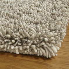 This high-depth shag rug in heathered naturals makes a plush foundation that's perfect for a bedroom or family room. Skilled artisans use thick felted low-twist yarns, some composed of two colors spun together, creating the overall, tweedy look. Woven on a loom, the yarns are then cut to create the shag. Crafted of pure wool, this rug will occasionally shed, especially during the first few months, which is easily managed with regular vacuuming.<br /><br />Order rugs (up to 6'x9') on-line…
