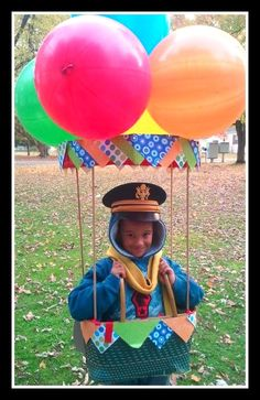 Homemade Hot Air Balloon Costume :) Made with love for my son, out of a picnic basket, 4 dowels, scrapbook paper and balloons !