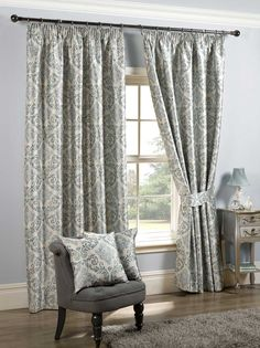 lined set of curtains with matching tie backs and cushions