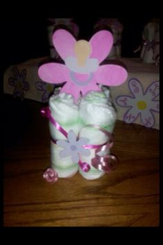 Baby shower girl center pieces will also maybe have cake pops stabbed in the diapers to hold in place