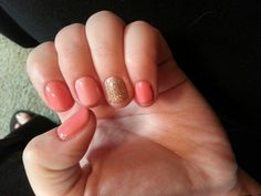 Coral and gold gel nails