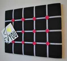Simple yet attractive memo board with fuchsia satin rosettes. Rosettes available in several colors to choose from.