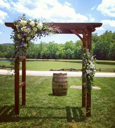 Love the flower placement/asymmetrical look - maybe add light fabric to the arbor (this looks just like the one at my venue) Rustic Barn Wedding Arbor Flowers Rustic Arbor, Wedding Arbor Rustic, Wedding Pergola, Wedding Ceremony Flowers, Rustic Barn, Diy Wedding Trellis, Wedding Arbours, Wedding Arbor Decorations, Wooden Arbor