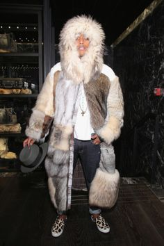 Phuck Pharrell.  He looks utterly ridiculous in this fur.