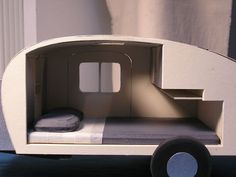 This is the most beautiful model of a teardrop camper I have ever seen!  I may just hope to replicate this with my plans to keep me sane while I am 'waiting' to save the money to build this!:
