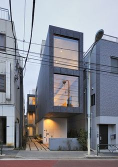Yanaka Terrace is a minimalist house located in Tokyo, Japan, designed by aat+makoto yokomizo, architects inc. This is the cooperative housing of nine houses which is facing Kototoi Street. Narrow House Designs, Modern Small House Design, Minimalist House Design, Minimalist Home, Architecture Design, Japanese Architecture, Residential Architecture, Casa Loft, Modern Townhouse