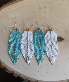 Feather silhouette earrings seed bead earrings beaded earrings yoga jewelry spiritual jewelry Southwestern style earrings bohemian earrings Sweet baby fringe feather earrings in shimmery aqua and white gold dipped beads or white with yellow gold di Fringe Earrings, Feather Earrings, Diy Earrings, Feather Jewelry, Hoop Earrings, Star Earrings, Gold Jewellery, Bespoke Jewellery, Fashion Jewellery