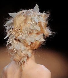 Golden strawbery blonde updo with ethereal chiffon leaf wreath and gold accents.