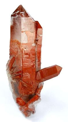 CKORQTZ-24 Quartz Oranje River, Namibia Charlie Key Small Cabinet, 9.3 x 4.0 x 2.7 cm Glassy and gemmy quartz crystals, to 8.7 cm in length are partially coated by a thin veneer of hematite, giving the specimen a beautiful, reddish coloring. The color contrast and zoning is super!