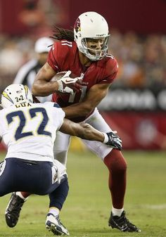 Wide receiver Larry Fitzgerald #11 of the Arizona Cardinals runs with the football after a reception during the preseason NFL game against the San Diego Chargers at the University of Phoenix Stadium on August 24, 2013 in Glendale, Arizona. (Photo by Christian Petersen/Getty Images)