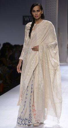 Ivory handwoven long jacket by RAHUL MISHRA. http://www.perniaspopupshop.com/wills-fashion-week/rahul-mishra #fashionweek #willslifestyleindiafashionweek