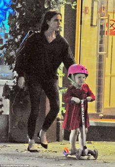 Catch me if you can! Victoria Beckham supervised daughter Harper Beckham, three, after a family dinner in Edera in Holland Park, West London, last week