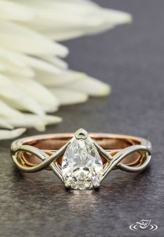 Two Tone Pear Cut Diamond Engagement Ring with Platinum Twists Over Rose Gold. Green Lake Jewelry 106245