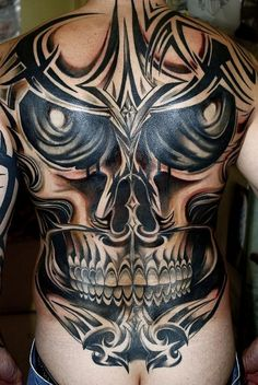 tribal-skull-tattoo-design-for-man-back-495x739 by Tattoo Holic, via Flickr