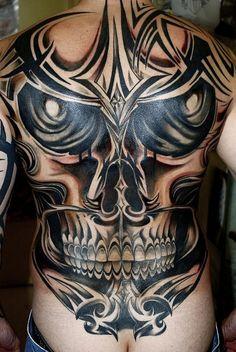 tribal-skull-tattoo-design-for-man-back-495x739 by Tattoo Holic, via Flickr