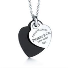 Tiffany & Co. Heart Necklace Tiffany & Co. Return to Tiffany sterling silver/ black onyx heart pendants with chain and connecting clasp as pictured. Silver pendant is medium size heart, onyx pendant is large heart. SOLD OUT ONLINE & Difficult to find! Pre owned condition with small flaw as shown in last picture. Items will come with original box and pouch.  no trades Tiffany & Co. Jewelry Necklaces