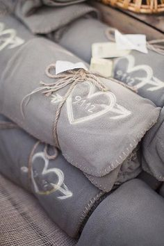 Guests used these blankets to snuggle up during an alfresco ceremony at an elegant barn wedding.