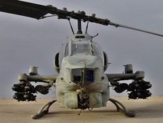 """The Bell AH-1Z Viper is a twin-engine attack helicopter based on the AH-1W SuperCobra, that was developed for the United States Marine Corps. The AH-1Z features a four-blade, bearingless, composite main rotor system, uprated transmission, and a new target sighting system.The AH-1Z is part of the H-1 upgrade program. It is also called """"Zulu Cobra"""" in reference to its variant letter."""