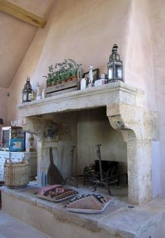 This French stone fireplace was purchased from Wharton Antiques for a large, privately-owned property recently built in the Cotswolds.Pictured here is the kitchen fireplace complete with a raised stone hearth that doubles as relaxed seating in front. Inglenook Fireplace, Rustic Fireplaces, Farmhouse Fireplace, Fireplace Surrounds, Fireplace Design, Fireplace Mantels, Fireplace Ideas, Fireplace Inserts, Mantles