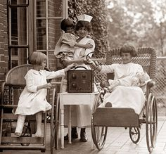 Children in the hospital listening to a radio. The picture was taken in 1924.