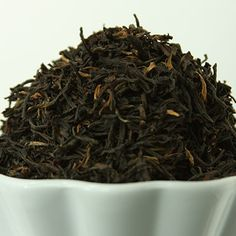 """This week we are celebrating our Traditional Black Teas. We will have them on sample so feel free to stop in and try some!  Today's Feature: Rohini Darjeeling Black.  Contains Caffeine. A first flush Darjeeling, this tea is harvested from the first tea growth of early spring. The brewed tea has the classic """"muscatel"""" flavor of wine-grapes, along with a brighter new-leaf taste. It makes a wonderful afternoon tea. It makes a wonderful afternoon tea, and a lovely tea with a large meal or…"""