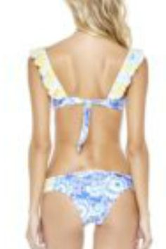 This ruffled halter style top has pads that can be removed at will for the washing of this garment.  The back ties to get closer tighter fit.  The front of this garment has a traditional bandeau style top and fit with the addition of two smaller ruffled straps  that can be worn off the shoulder to add exponentially more cuteness.  There is a small tie in the front of garment which is removable.  This garment has a fun flirty print in indigo white yellow and Carolina blue.  Bottoms are…
