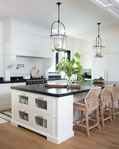 Fall in love with this Arcadia custom home. Beautiful traditional white cabinetry with contrasting black countertops and wicker island bar stools. Modern Kitchen Island, Grey Kitchen Cabinets, Modern Farmhouse Kitchens, Country Kitchen, Home Kitchens, Farmhouse Style, Cottage Kitchens, Kitchen Counters, Home Decor Kitchen