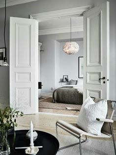 Classic elegance and Nordic minimalism paired in this living room and bedroom - - Classic elegance and Nordic minimalism paired in this living room and bedroom. Classic elegance and Nordic minimalism paired in this living room and bedroom. Home Bedroom Doors Interior, Interior Design, House Interior, Bedroom Interior, Home, Interior, Interior Barn Doors, Home Bedroom, Home Decor