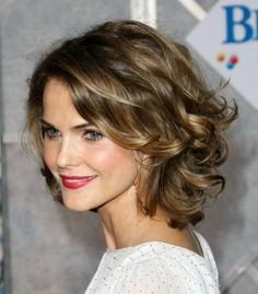 Thick wavy curls! I LOVE this cut!  If I had longer hair this would be my choice!