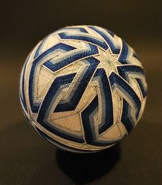 The tradition of Temari threadballs is centuries old and found in both, Chinese as well as Japanese cultures. It spansalmost 1400 years and have transformed from play objects to objects of art, evolving from a rough, leather-ballfoot game, to a child'stoy, to an opulentandcourtlyactivity, thenback to a children's toy again, and finally, to an ornamental object of elaborate design once more.