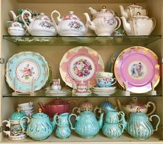 sc- Royal Albert teapots and creamer, top shelf, far left. Blue cup and saucer, middle shelf, off center, right, also Royal Albert.