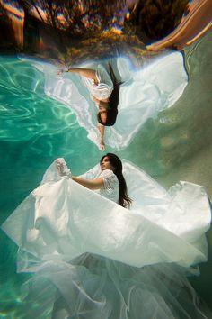 Artistic underwater trash-the-dress photos