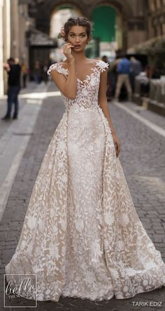 Tarik Ediz Wedding Dresses 2019 - The White Bridal Collection. Lace fitted sheath wedding dress with overskirt illusion off the shoulder neckline See more gorgeous wedding dresses by clicking on the photo Wedding Dress Trends, Gorgeous Wedding Dress, White Wedding Dresses, Designer Wedding Dresses, Bridal Dresses, Wedding Gowns, Lace Wedding, Reception Dresses, Wedding Reception
