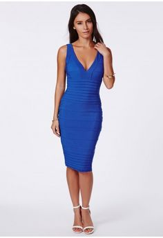 In this season's cute cobalt blue hue, this beautiful bodycon dress is a showstopper. The bandage design and gorgeously flattering style will have all eyes on you this season. Make a total fashion statement with superbly high heels, bright ...