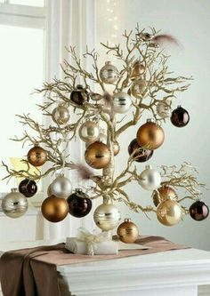 Cristhmas Tree Decorations Ideas : Tabletop Christmas Tree…love the branches and copper/silver/chocolate ornaments Tabletop Christmas Tree, Noel Christmas, Christmas Countdown, All Things Christmas, Winter Christmas, Christmas Crafts, Christmas Ornaments, Modern Christmas, Christmas Tree Ideas For Small Spaces