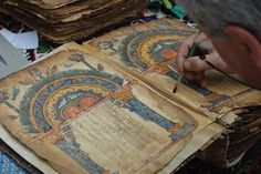 A conservator at work on the Garima Gospels.    What could be the world's earliest illustrated Christian manuscript has been found in a remote Ethiopian monastery. The Garima Gospels were previously assumed to date from about 1100AD, but radiocarbon dating conducted in Oxford suggests they were made between 330 and 650AD.