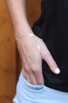 Two vintage filigree chains cradle your hand in this design. One chain loops around the thumb for support, and the other can be wrapped around the finger of your choice.