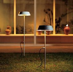 These are cool looking outdoor lights reminiscent of indoor table lamps.