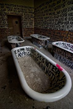 A room in an abandoned psychiatric hospital. I find this unsettling, but really fascinating too.