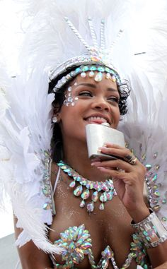 Glitter, jewels, and a smile make Rihanna shine during Barbados' Kadooment Day parade.