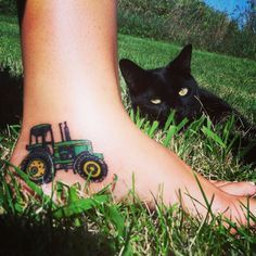 I will never forget where I came from. My first tattoo I grew up on a dairy farm and Ive spent many hours in that tractor with beloved family members. Also my kitty Lola got in the picture. #tattoo #tractor #country