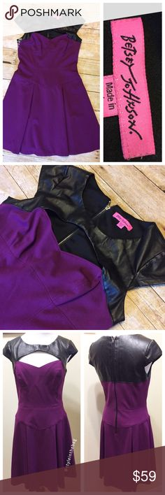 """Betsey Johnson Fit and Flare Faux Leather Shoulder Excellent condition Betsey Johnson dress. 35.5"""" from top of shoulder. Sweetheart style peekaboo neckline with faux leather shoulder details. Waist 14.5"""" across laying fat. Has some stretch. Zip back. 17.5"""" armpit to armpit laying flat. Purple fabric is rayon/nylon/spandex blend. Cap sleeves. Smoke free home. No holes or stains or pilling. This dress has a bit of a punk or retro feel super cute! Betsey Johnson Dresses Mini"""