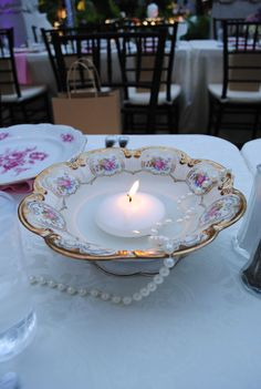 Floating candles in a teacup saucer