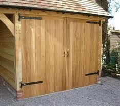 oak garage doors - Google Search Custom Garage Doors, Wood Garage Doors, Shed Doors, Barn Doors, Garage Extension, Side Extension, Oak Framed Buildings, Garage Floor Paint, Rustic Houses