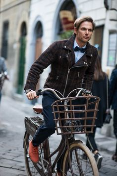 Florence, men's street style, man wearing wool plaid bomber jacket and bowtie on bike