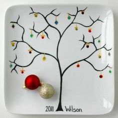 Personalized Family Name Christmas Tree Ornament Plate.  a white plate or platter from the thrift store.. a little 'vision' and some paint for glass and bingo.. we can do this!!  doesn't have to be for Christmas.. choose any theme you like!!