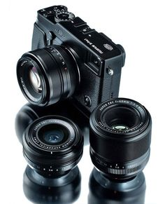 FUJIFILM X-Pro1. I would LOVE to have this setup for traveling. I love my Mark II, but I would love this setup on the go.
