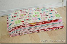 """I bought a quarter yard of each flannel fabric (I got 2 burp rags out of each quarter yard plus some left over) and, using my rotary cutter, cut them to 8x16"""". I bought a yard of the chenille (or terry cloth) and just cut out as many 8x16 pieces as I could."""
