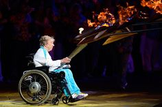 the cauldron is lit by Margaret Maughan who won Britain's first Paralympic metal in Rome