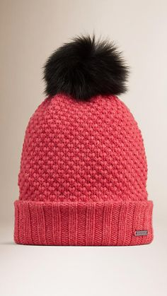Burberry Soft wool cashmere beanie with a fur pom-pom Engineered in contrasting textured and ribbed stitches Turnback hem. Discover more accessories at Burberry.com